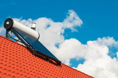 A solar water heater on a roof.