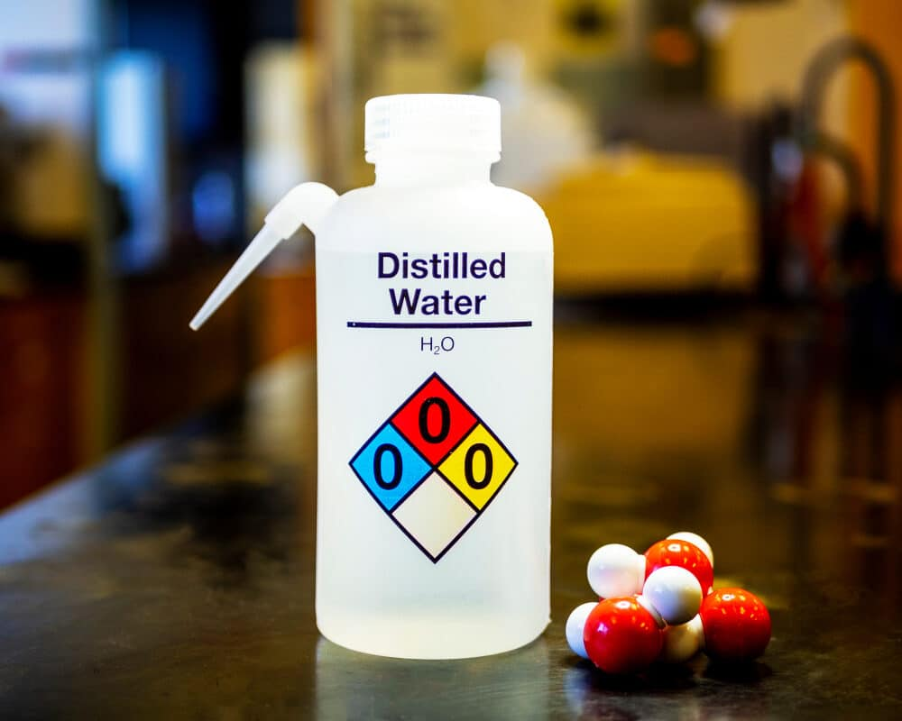 A bottle filled with distilled water for use in laboratories.