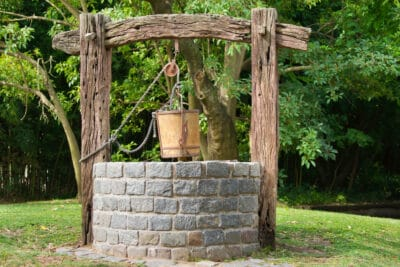 A water well in a forest.