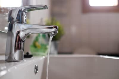 Open chrome faucet washbasin with low water pressure
