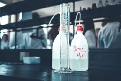 Distilled purified deionised water in plastic bottles with a pump