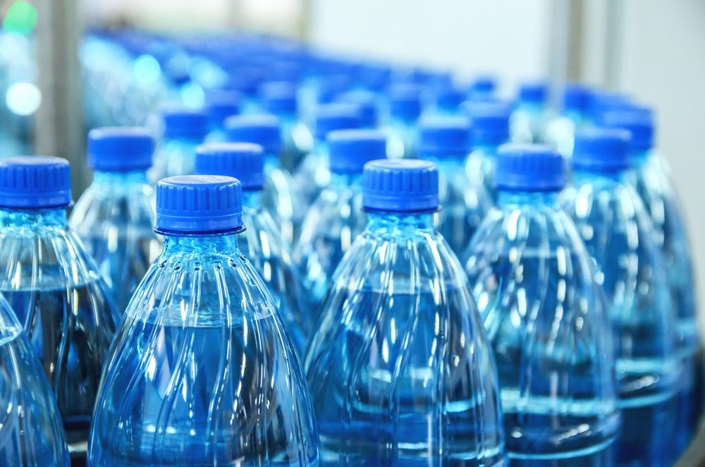 Closeup on mineral water bottles in raw and lines